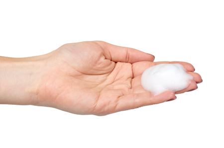 Hand met witte schuimbellen, schoonheid gladde mousse, close-up foto. Geïsoleerd op witte achtergrond Stockfoto