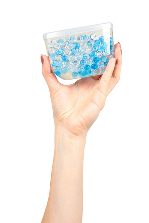 Hand with blue gel fragrance air freshener, bathroom deodorant. Isolated on white background Stock Photo