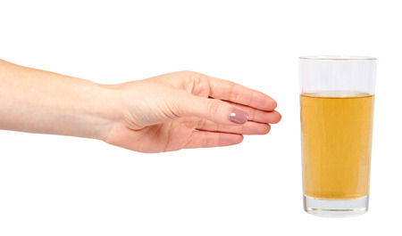 Hand with fresh apple juice in a glass, healthy beverage. Isolated on white background
