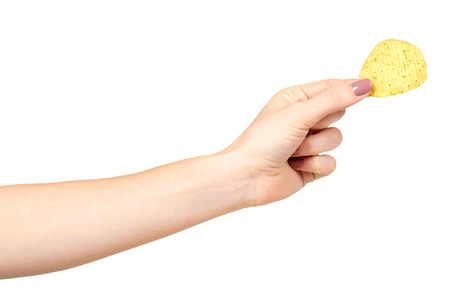 Hand with golden color potato chips, crunchy and wavy. Isolated on white background
