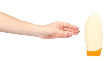 Hand with plastic cosmetic bottle, shampoo and soap gel. Isolated on white background
