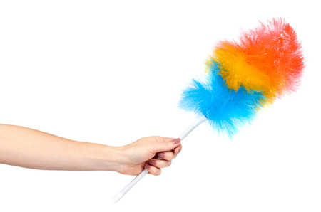 Hand with soft colorful duster, synthetic feather broom, fluffy cleaner. Isolated on white background