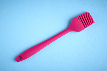 Silicone brush for prepare food, flat lay composition and top view photo