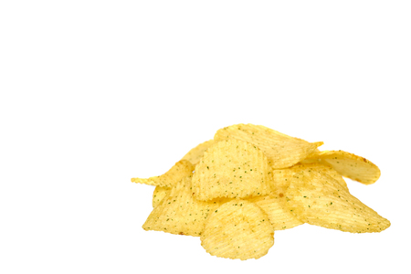 Golden color potato chips, crunchy and wavy. Isolated on white background. Copy space template