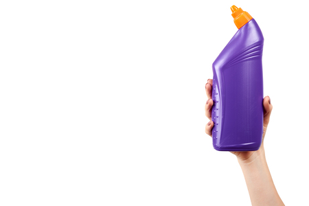 Hand with purple toilet gel, domestic hygiene, plastic bottle. Isolated on white background. Copy space template