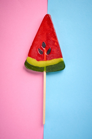 Home made sugar candy, sweet dessert on stick, flat lay composition and top view photo