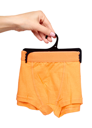 Hand with bright boxer underwear, cotton pants. Isolated on white background 스톡 콘텐츠