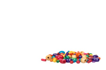 Colored wooden beads, decorative accessory for hand made. Isolated on a white background. Copy space template 스톡 콘텐츠