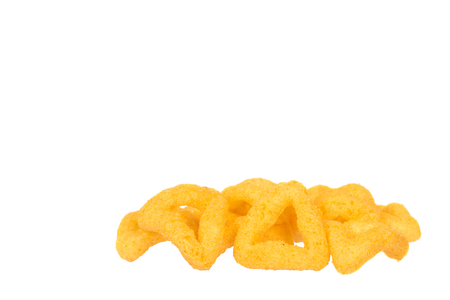 Cheese puff sticks, crunchy corn snack, unhealthy food. Isolated on white background. Copy space template