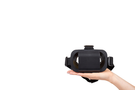 Hand with black plastic VR headset, Virtual Reality mask. Isolated on white background. Copy space template 스톡 콘텐츠