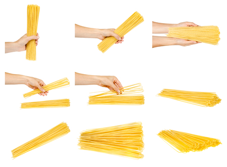 Hand with raw golden spaghetti, set and collection. Isolated on white background 스톡 콘텐츠