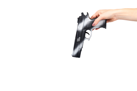 Hand with black gun, side view pistol, crime and military concept. Isolated on white background. Copy space template