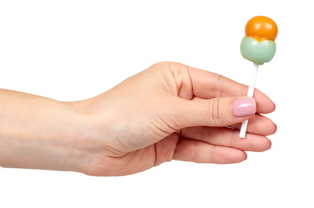 Hand with color lollipop, bright cool candy. Isolated on white background