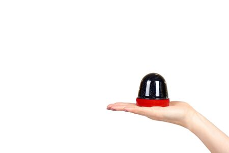 Hand with black slime toy for kids, glitters and goo. Isolated on white background. Copy space template