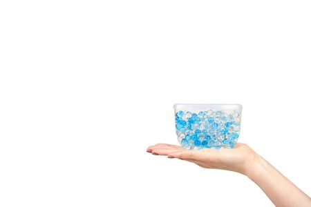 Hand with blue gel fragrance air fresher, bathroom deodorant. Isolated on white background. Copy space template Archivio Fotografico