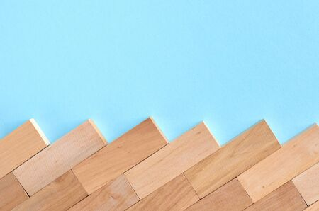 Brown wooden blocks idea on blue background composition. Flat lay and top view photo