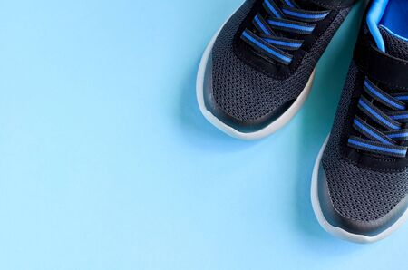Sneakers on blue background composition, shoes for run. Flat lay and top view photo Stok Fotoğraf