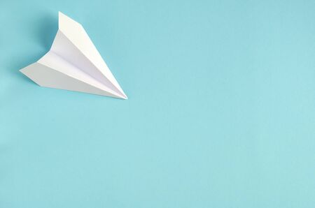 White paper plane on blue background composition. Flat lay and top view photo Stok Fotoğraf