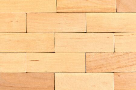 Brown wooden blocks wall composition. Flat lay and top view photo