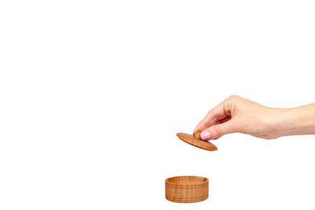 Hand with wooden container, round case. Isolated on white background. Copy space template. Archivio Fotografico - 131194061