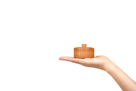 Hand with wooden container, round case. Isolated on white background. Copy space template. Archivio Fotografico - 131191829