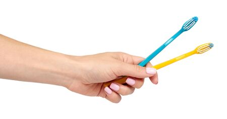 Hand with color toothbrush, dental care and freshness. Isolated on white background.