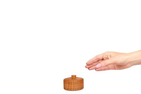 Hand with wooden container, round case. Isolated on white background. Copy space template. Stok Fotoğraf