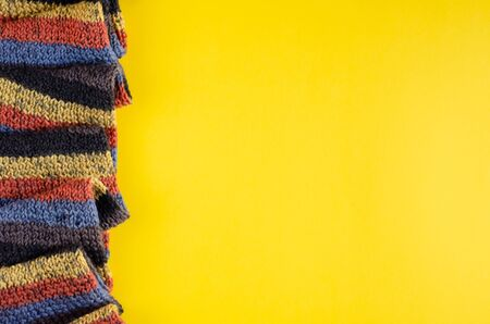 Woolen scarf composition on yellow background. Flat lay, layout and tabletop mockup with copy space. Stock fotó
