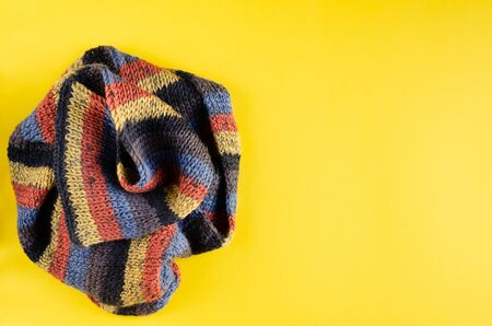 Woolen scarf composition on yellow background. Flat lay, layout and tabletop mockup with copy space. Stock Photo
