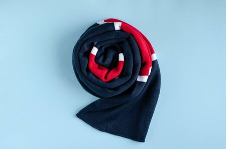 Cotton colored scarf composition on blue background. Flat lay, layout and tabletop mockup with copy space. Stock Photo
