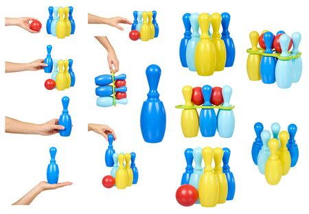 Hand with toy bowling for fun game, plastic skittle and ball, set and collection. Isolated on white background