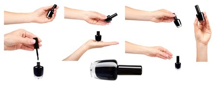 Hand with black nail polish bottle , set and collection. Isolated on white background 写真素材 - 133666336