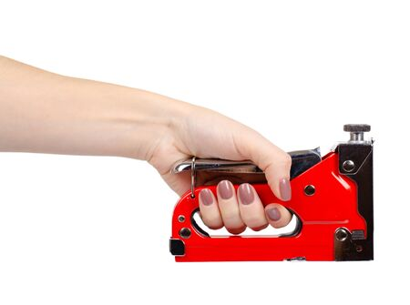 Hand with red industrial stapler, furniture industry hardware. Isolated on white background.