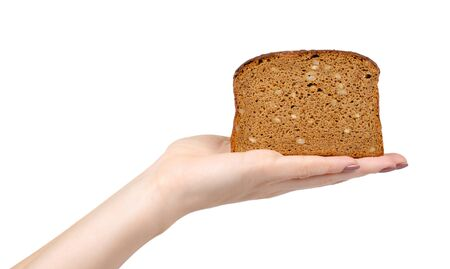 Hand with slice of brown bread with seeds, heathy food. Isolated on white background. 写真素材