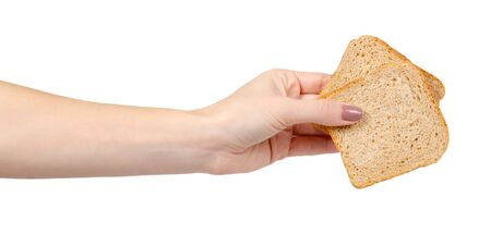 Hand with slice of whole wheat bread, healthy food. Isolated on white background. 写真素材
