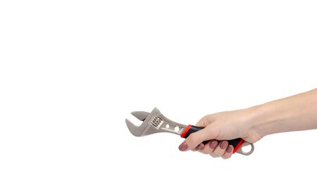 Hand with adjustable wrench, work tool. Isolated on white background. Copy space, template.