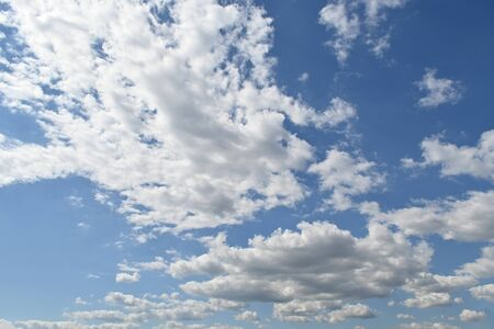White fluffy clouds on the blue sky, nature background, bright and vivid cloudscape.