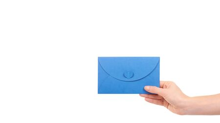 Hand with blank mail envelope with heart. Isolated on white background. Copy space, template.