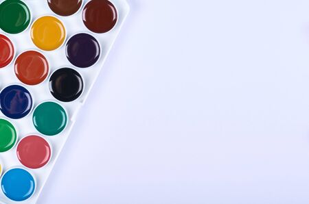 Watercolor paint white background. Flat lay, overhead view image. Copy space, template.