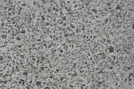 Stone background, rough rock texture, construction material. Stock Photo