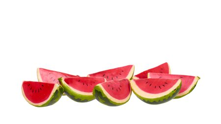 Decorative wooden watermelon slice. Isolated on white background. Copy space, template.