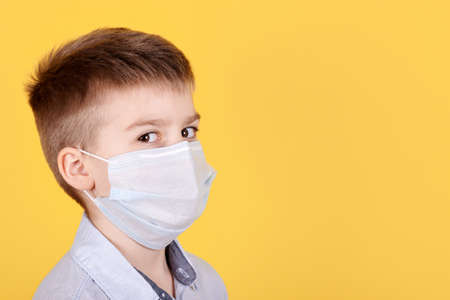 Portrait of a brunette boy in medical mask.