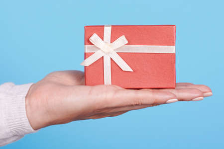 Hand with red gift box. 스톡 콘텐츠
