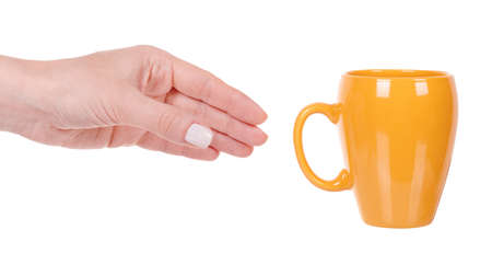 Yellow coffee mug, porcelain kitchen utensil.