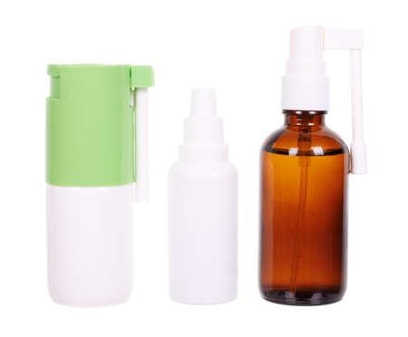 Nasal drops and medical throat spray bottles.