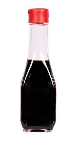 Soy sauce in glass bottle with red cup. 免版税图像