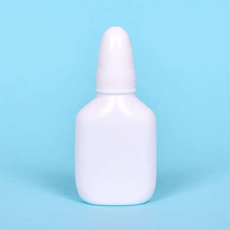 Nasal spray, drops in white bottle.