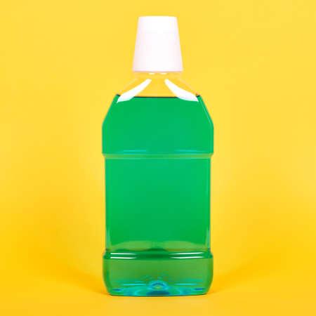 Green mouthwash bottle, dental health care. Stock fotó