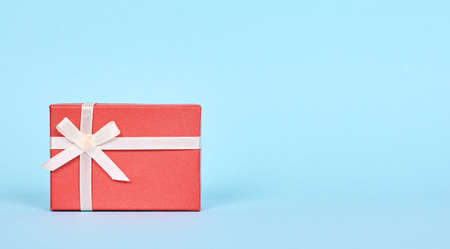 Red gift box with ribbon. 스톡 콘텐츠