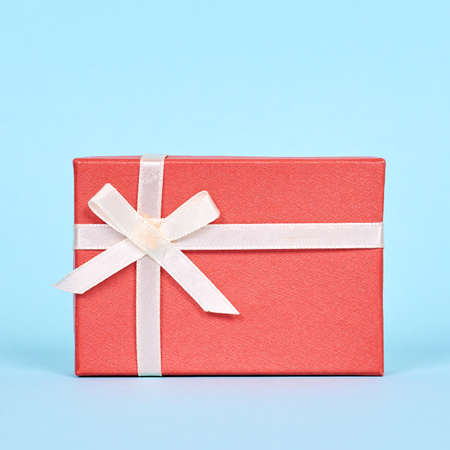 Red gift box with ribbon. Stock fotó